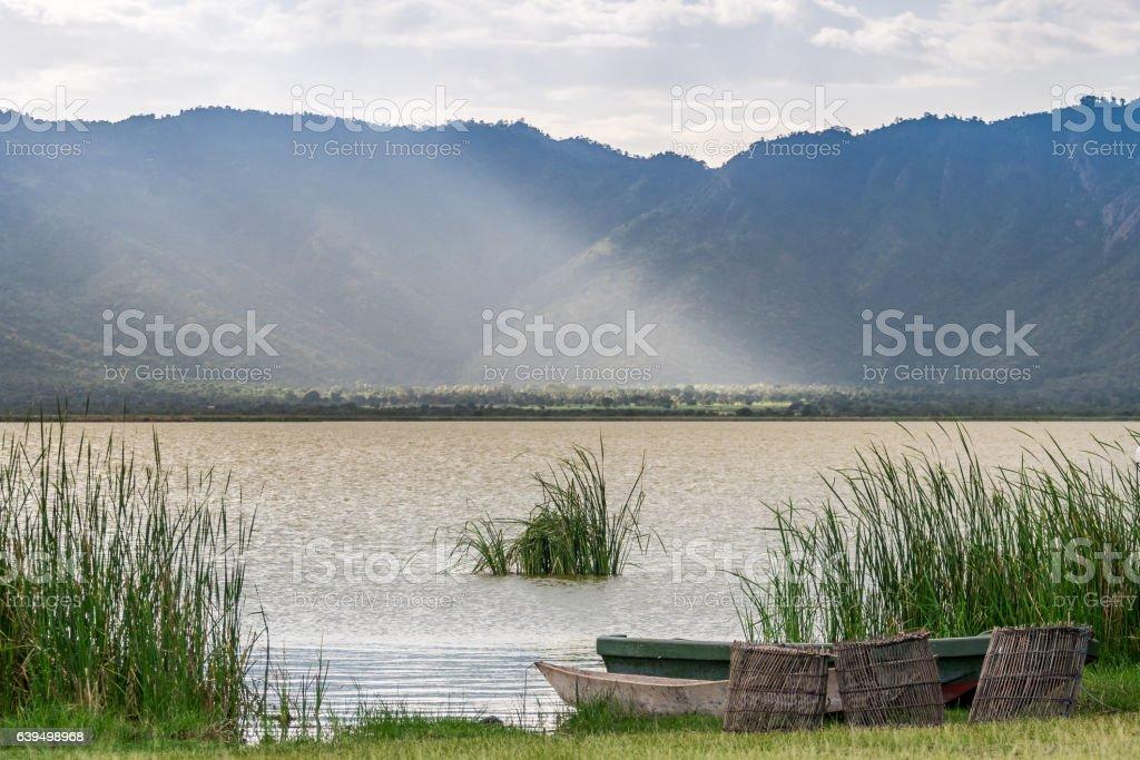 Fishing baskets and boats over Lake Jipe, Kenya stock photo