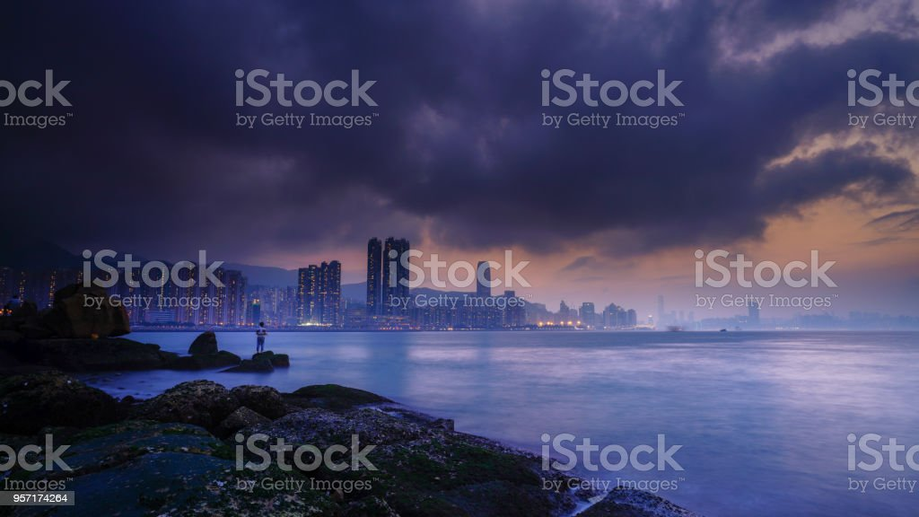 fishing before the thunderstorm comes stock photo