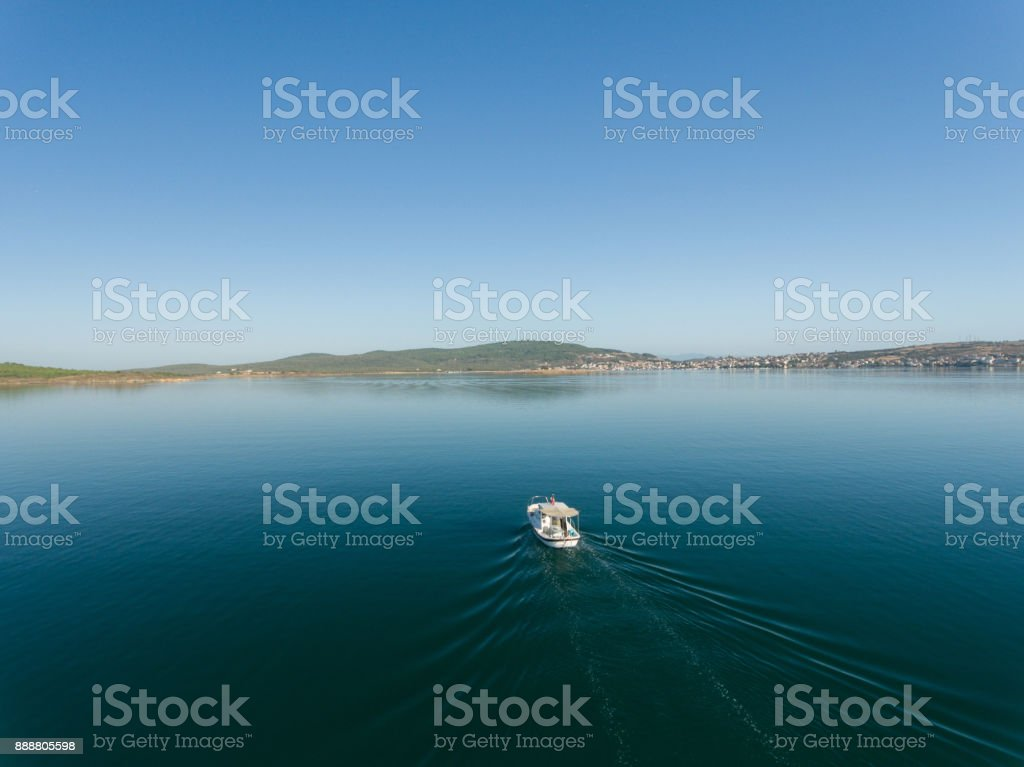 Fishing boat alone in the sea stock photo