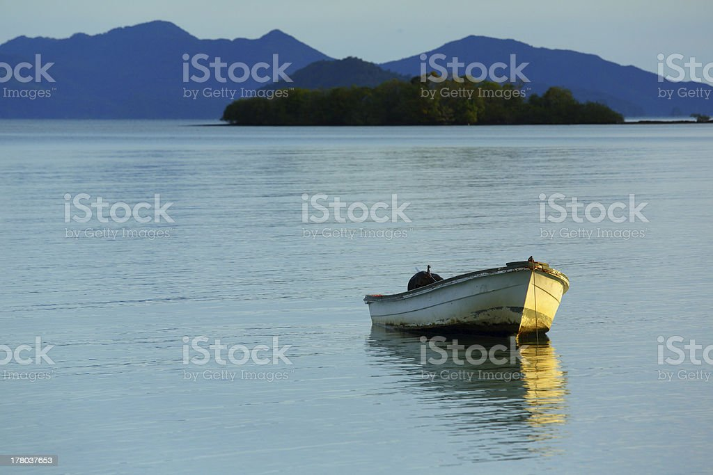 Fishing Boat Alone on Calm Morning Sea royalty-free stock photo