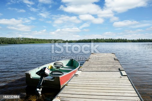 fishing boat on wilderness lake with bright sky (XXL)