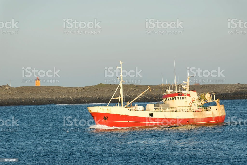 Fishing boat arriving royalty-free stock photo