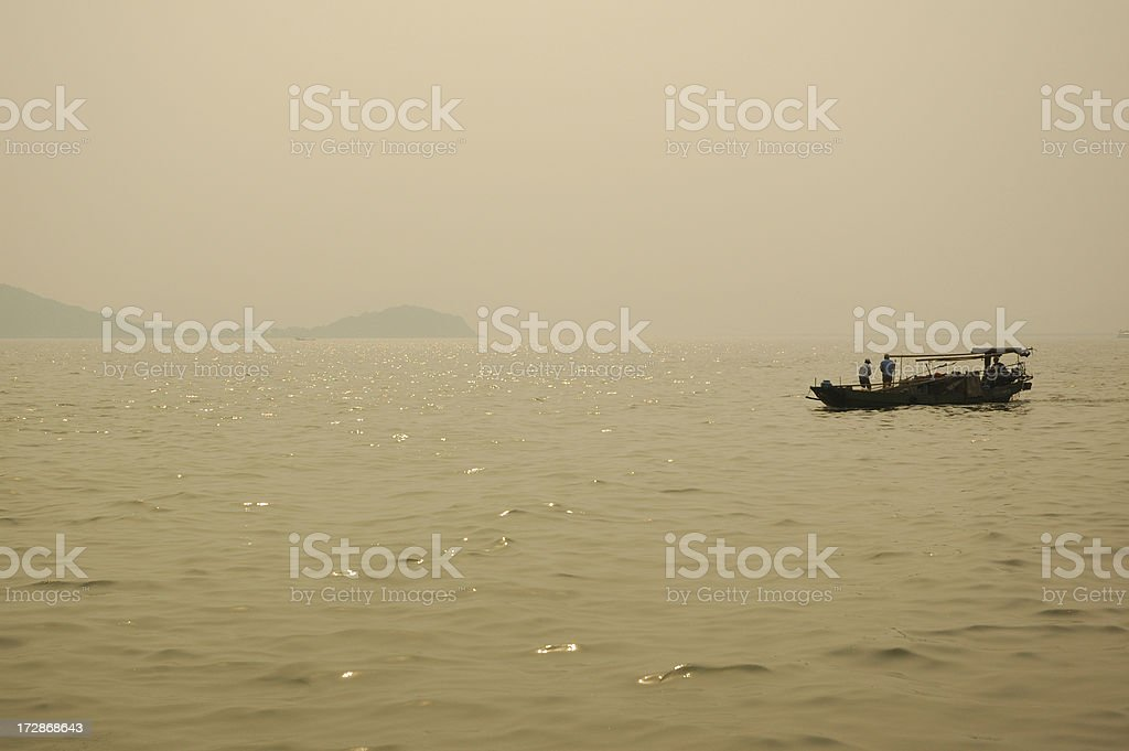 Fishing Boat at Dusk on Lake Tai royalty-free stock photo