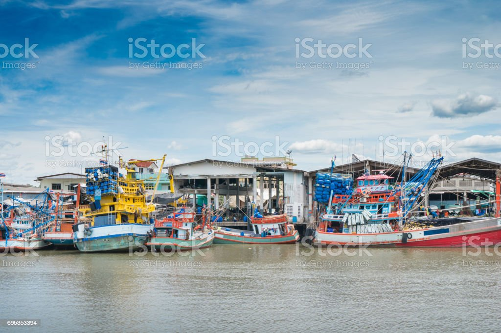 Fishing boat at fresh sea food market in Rayong distric,Thailand. stock photo