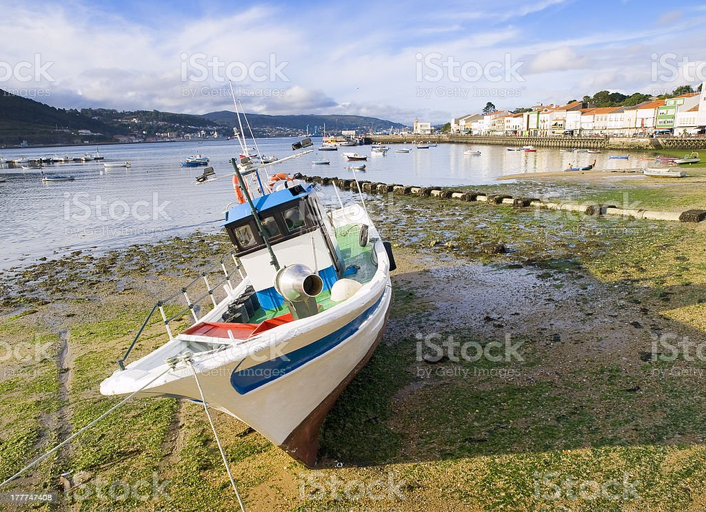 Fishing boat at low tide in Galicia royalty-free stock photo