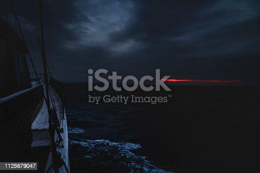 Fishing boat at sea, at sunrise