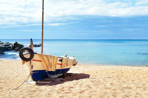 Fishing Boat Beached In Lloret De Mar Spain Stock Photo - Download Image Now