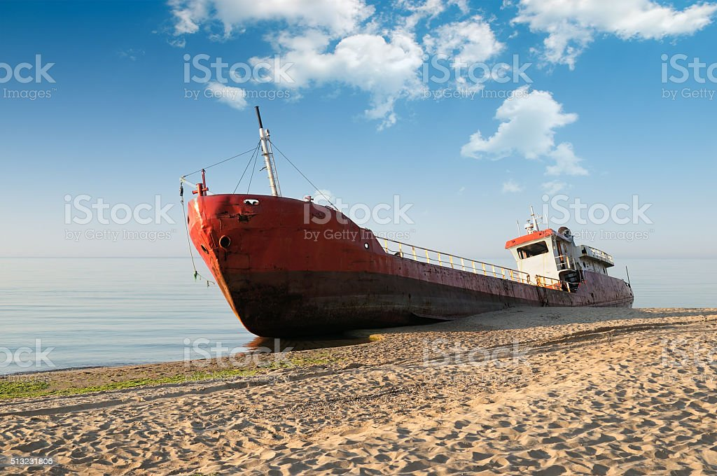 Fishing boat beached stock photo