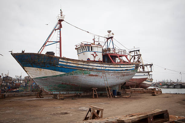 Fishing boat being repaired in Essaouira Morocco. stock photo