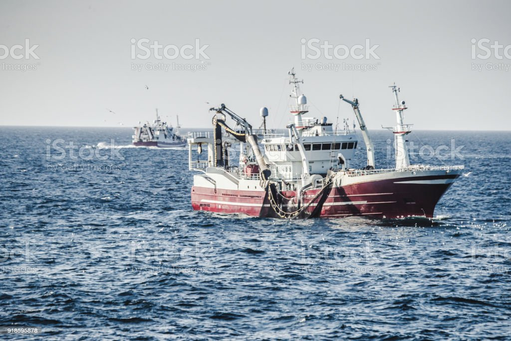 Fishing boat fishing with a purse seine stock photo