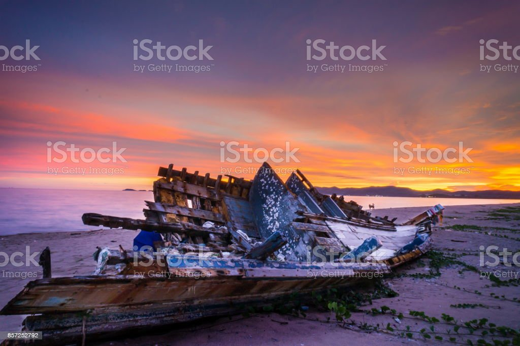 Fishing boat founder on the beach stock photo