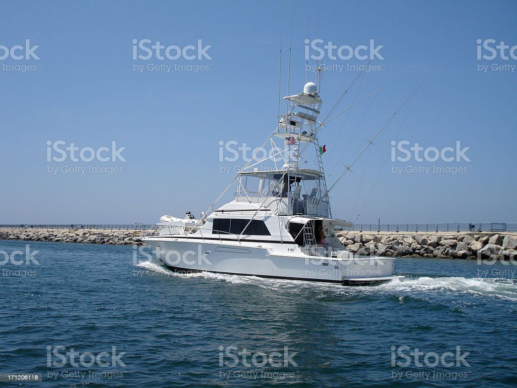 Fishing Boat Going Out to Sea stock photo