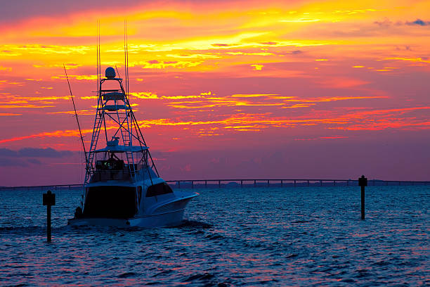 A fishing boat heading out for an early morning catch