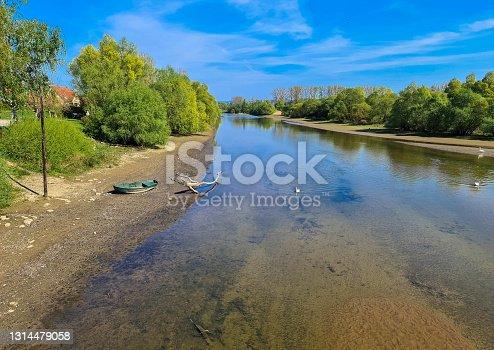 A fishing boat in Delta de la Sauer National Nature Reserve. Rhine floodplain reserves. Munchausen, Alsace, France.
