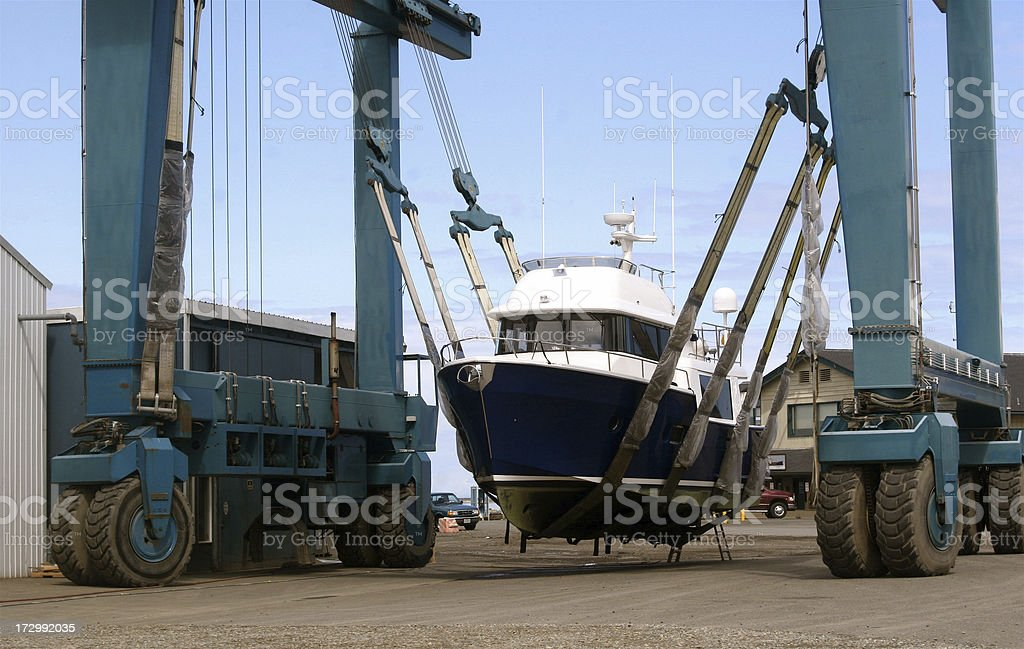 Fishing Boat in Dry Dock Sling royalty-free stock photo