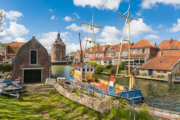 Fishing boat in Enkhuizen in the Netherlands with the historic city gate (Drommedaris) in the background.