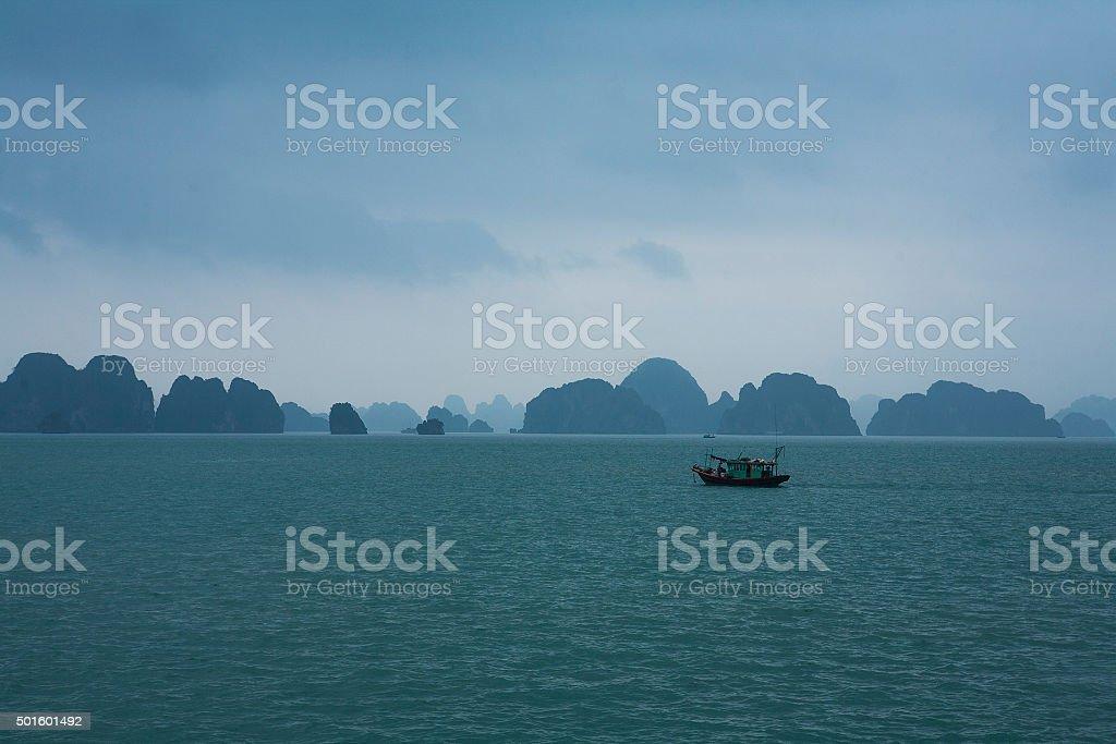 Fishing boat in Halong Bay stock photo