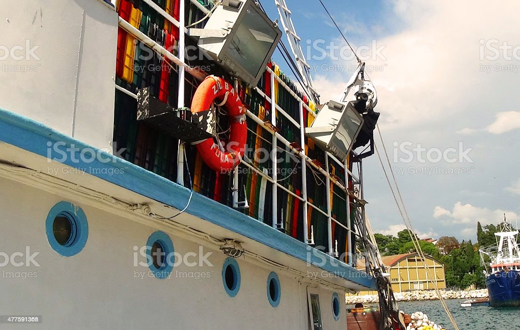 Fishing boat in harbour stock photo