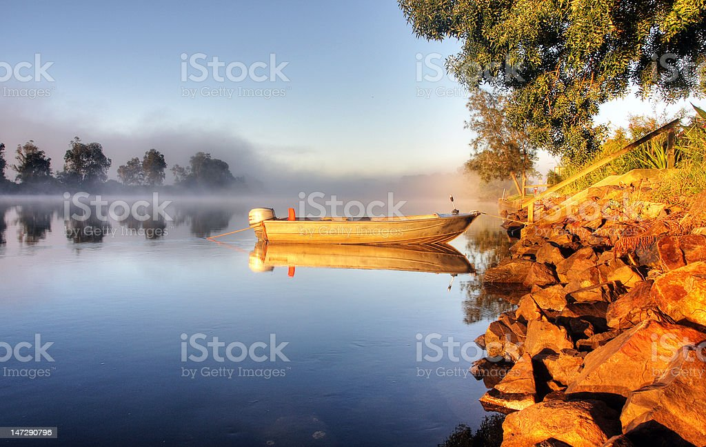 Fishing boat in mist royalty-free stock photo
