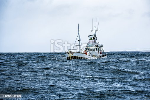 fishing boat in open cold sever ocean