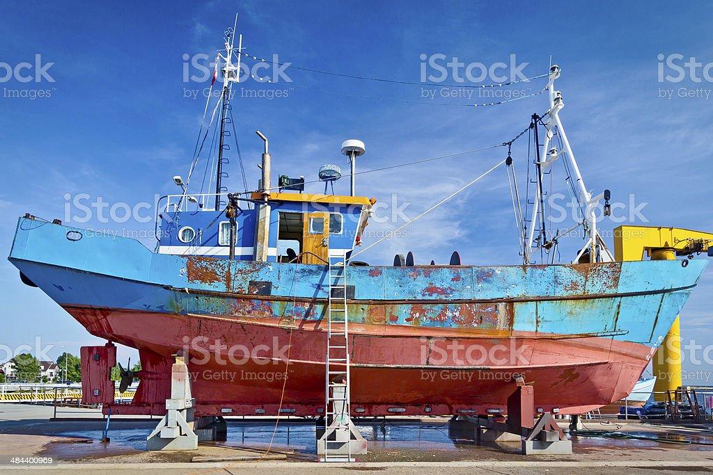Fishing boat in repair yard stock photo