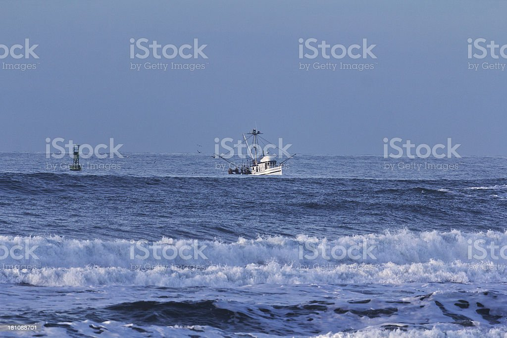 Fishing boat in storm stock photo