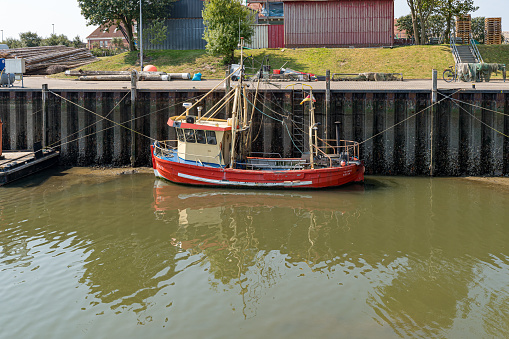 Fishing boat in the harbor of Buesum in Northern Friesland at the North Sea in Germany