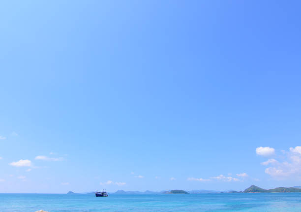 Fishing boat in the ocean stock photo
