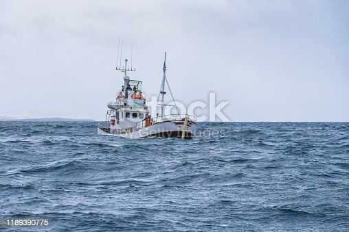 fishing boat in the open cold sever ocean