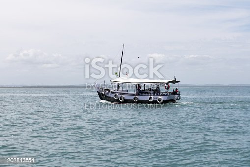 Bahia, Brazil - January 2020: Fishing boat in the middle of the ocean. Morro de Sao Paulo, Salvador, Brazil. Hill.