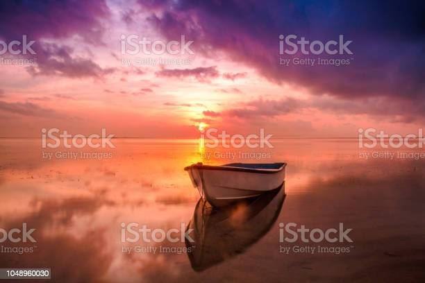 Photo of Fishing boat in the sea reflection in the water