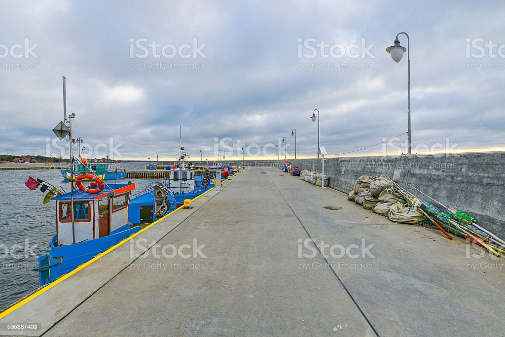 Fishing boat in the small port stock photo