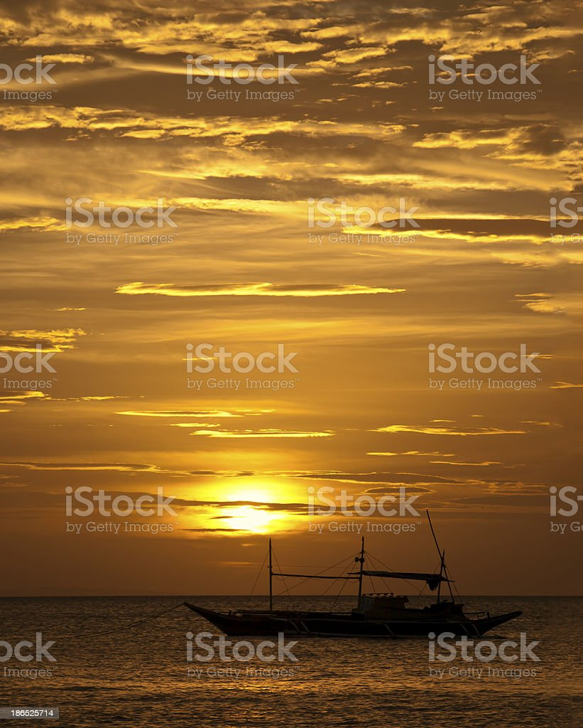 fishing boat in the sunset royalty-free stock photo