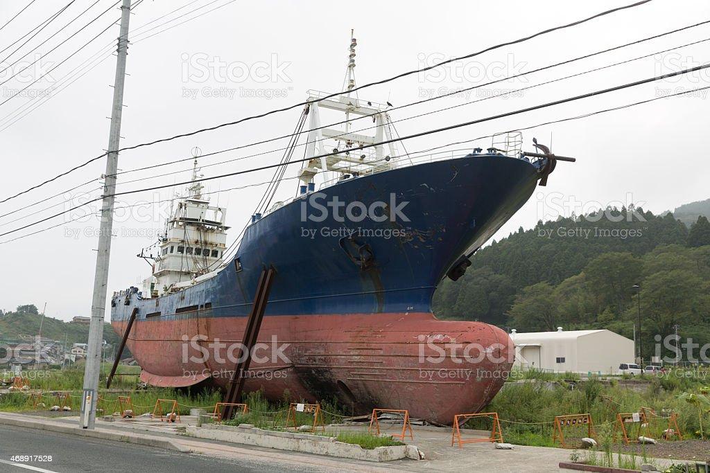 Fishing boat inland by the tsunami in Kesennuma, Japan stock photo