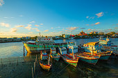 River and moored fishing boats in Prachuap Khiri Khan, a seaside town in the gulf of Thailand.