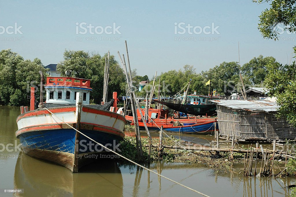 Fishing Boat lays alongside the Dockage stock photo