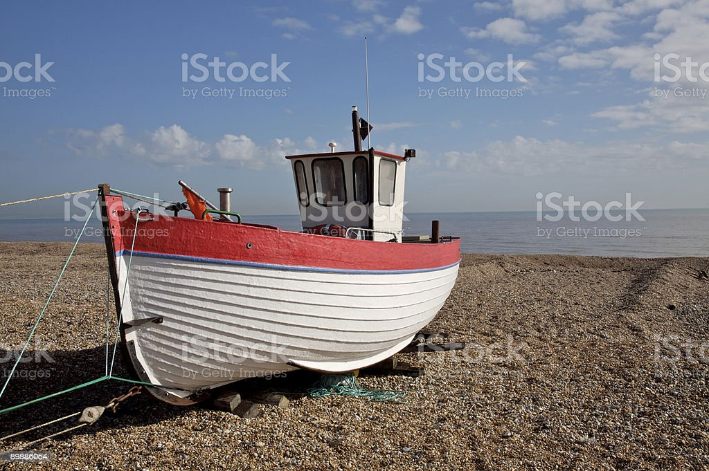 Fishing boat moored on beach royalty-free stock photo