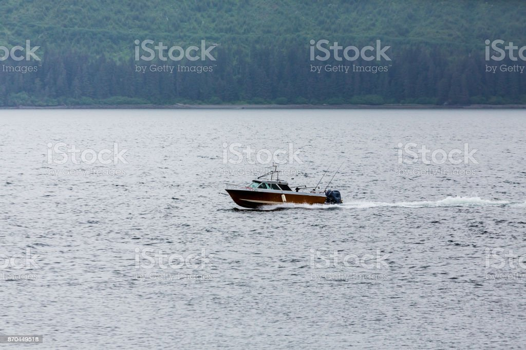 Fishing Boat Motoring Through Alaska stock photo