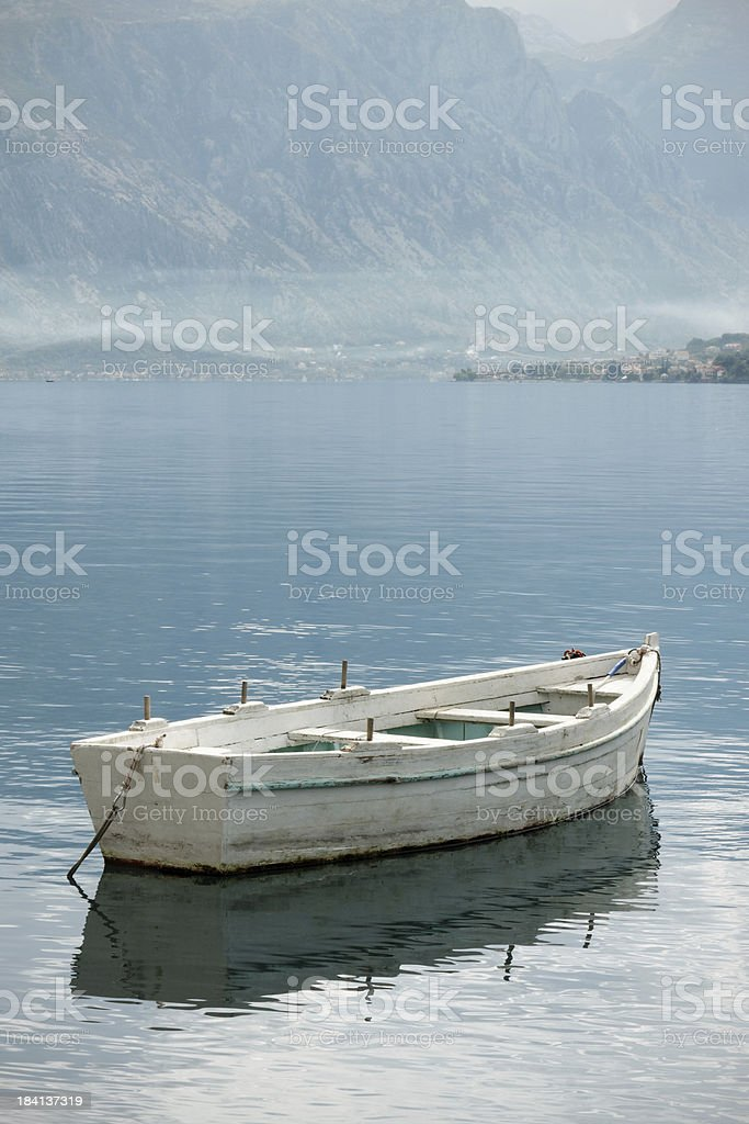 Fishing boat on a lake royalty-free stock photo