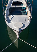 Fishing boat on a sunny afternoon on the calm Aegean Sea on the island of Evia, Greece
