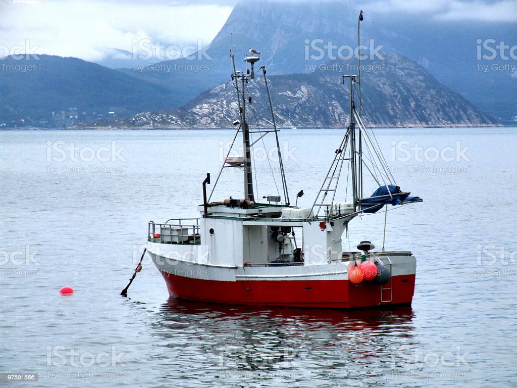Fishing boat on anchor in haven royalty-free stock photo