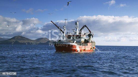 Fishing boat on open waters near Dingle Peninsula coast.