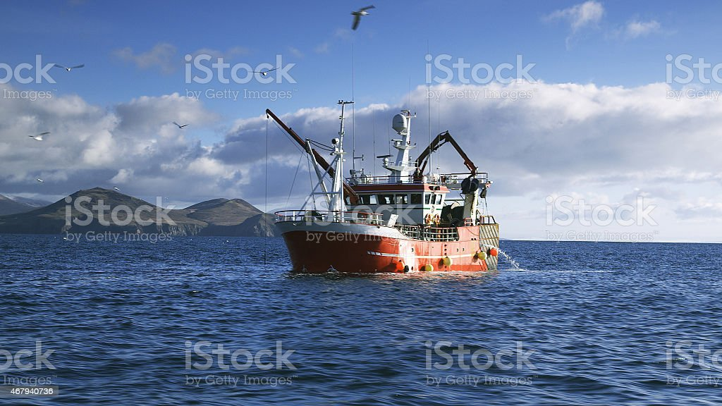 Fishing Boat on Atlantic Ocean at Dingle Peninsula in Ireland stock photo
