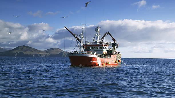 Fishing Boat on Atlantic Ocean at Dingle Peninsula in Ireland stock photo