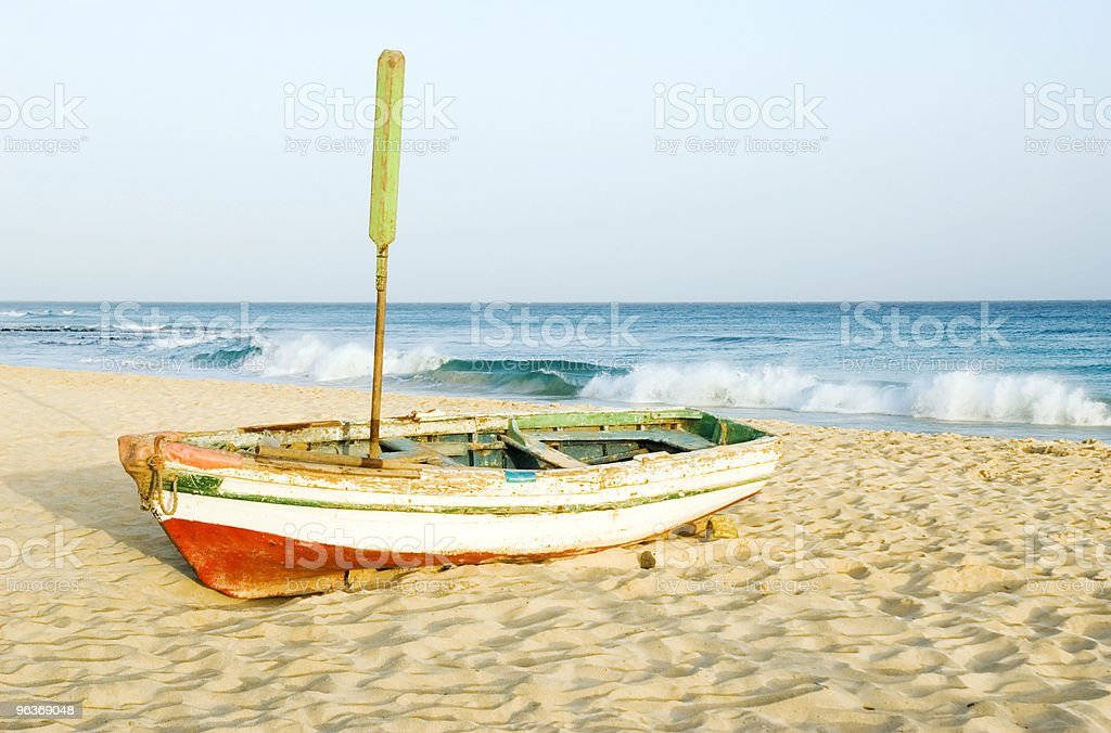 Fishing boat on beach. stock photo