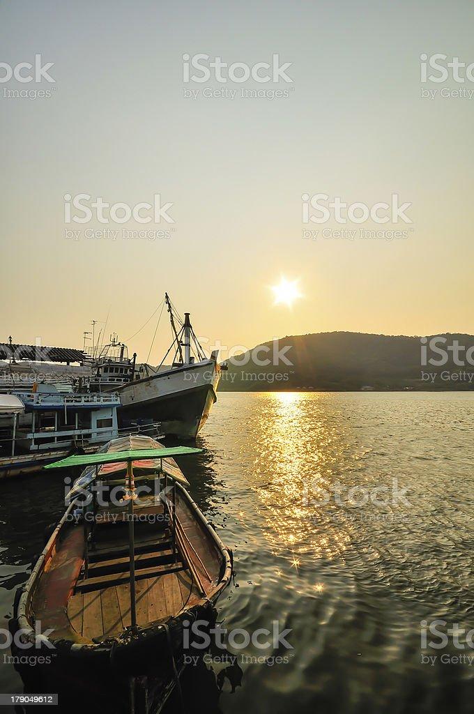 Fishing Boat on Lake at Sunset royalty-free stock photo
