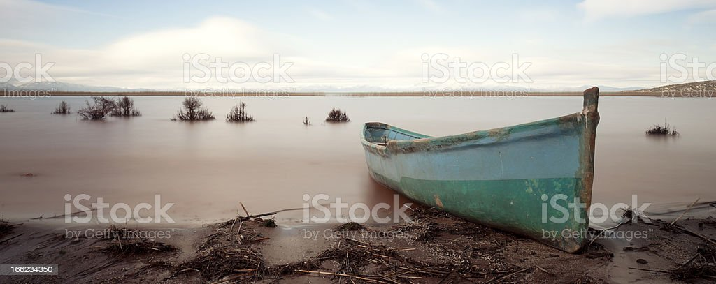 Fishing boat on lake beach royalty-free stock photo