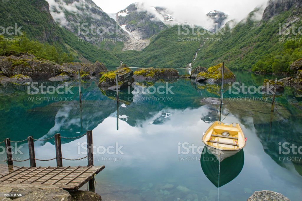 Fishing boat on mountain lake Norway stock photo