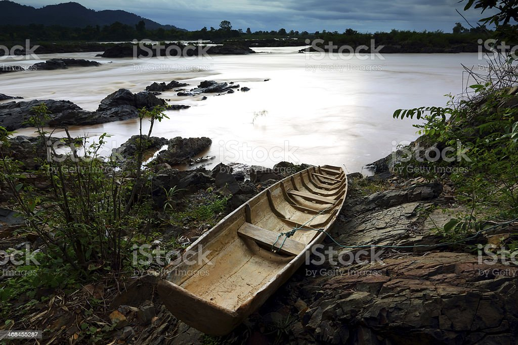 Fishing boat on Somphamit Waterfall, Southern Laos royalty-free stock photo