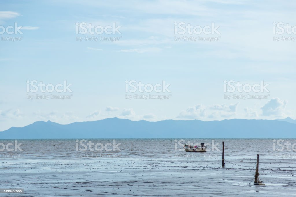 Fishing Boat on the Beach at Sea and blue Mountain background - Royalty-free Aluminum Stock Photo